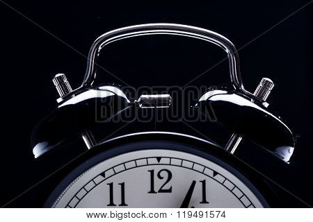 alarm clock showing different times black background