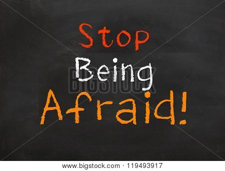 Motivational saying that you need to focus on what you want and not worry about being afraid to do it poster