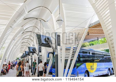 Modern Central Bus Station With People Waiting For Departure Or Friends Arrival
