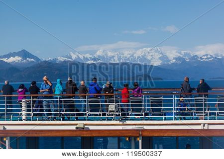 Tourists watching the glacier on the Cruise Ship