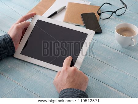Men Hand Clicks A Blank Screen Tablet Computer
