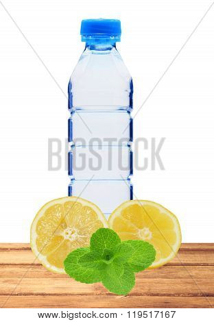 Blue Bottle With Water, Mint And Fresh Yellow Lemon On Table Isolated On White