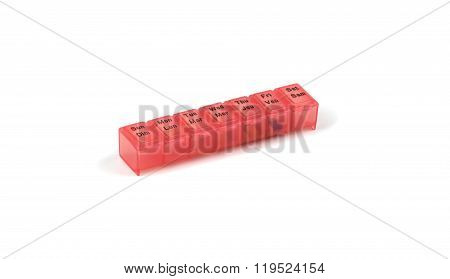 Red plastic pill container.