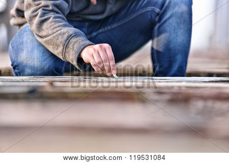Hand Of A Young Man Extinguishing Cigarette On A Old Bridge. Concept Quit Smoking. Selective Focus