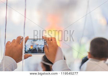 Taking A Photo With Phone During Casting Of Buddha Statue