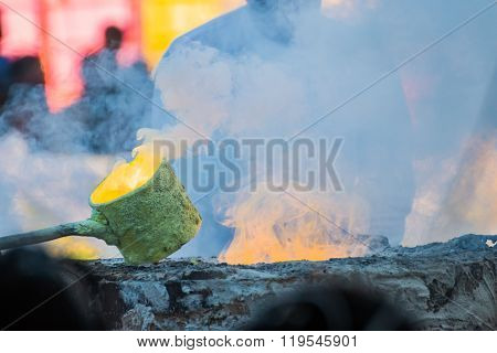Molten Gold Being Poured Into Buddha Statue Moulds