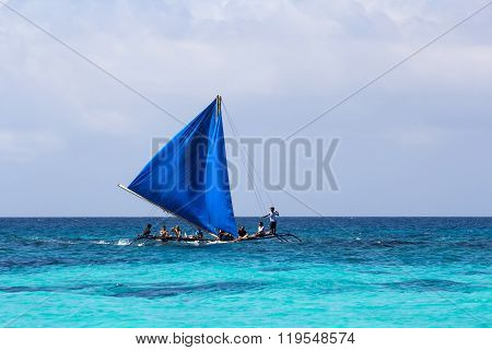 Local Wooden Sailing Boat At The Sea With People
