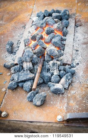 Iron Rod Put To Heat In The Hot Coals.