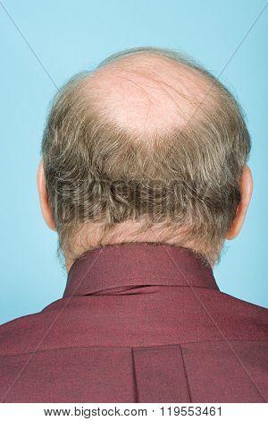 Rear view of balding man