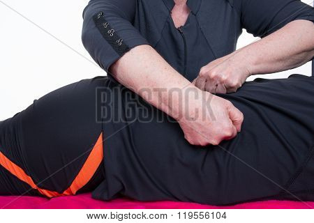 Masseur Massaging The Back Of A Man In A Room