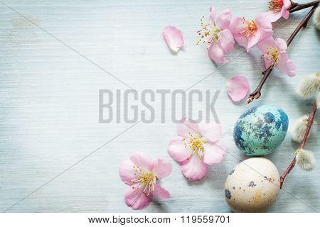 Easter eggs and cherry blossom retro blue background