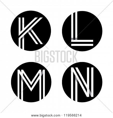 Capital letters K, L, M, N.  In a black circle.