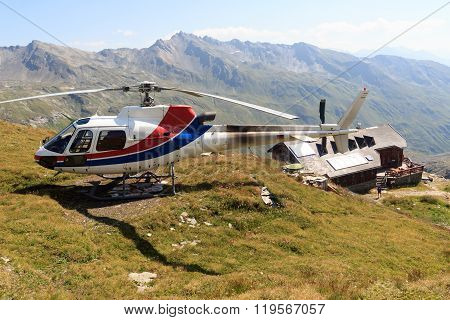 Transport Helicopter Landed Near Alpine Hut And Mountain Panorama In Hohe Tauern Alps, Austria