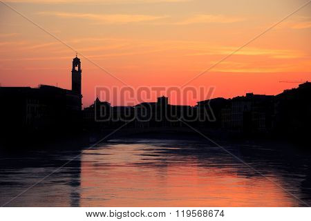 Sunset Over Black Silhouette Of Pisa Cityline And Aron River