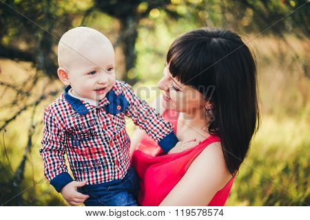 Mother with her baby son in autumn park