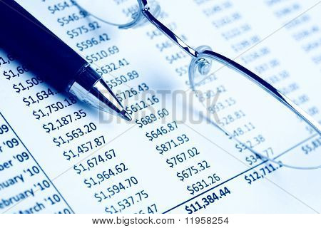 Closeup of a chart with pen & glasses
