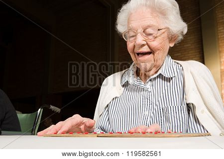 Senior woman playing bingo