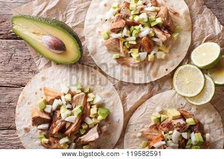 Tortilla With Carnitas, Onions And Avocado Close-up. Horizontal Top View