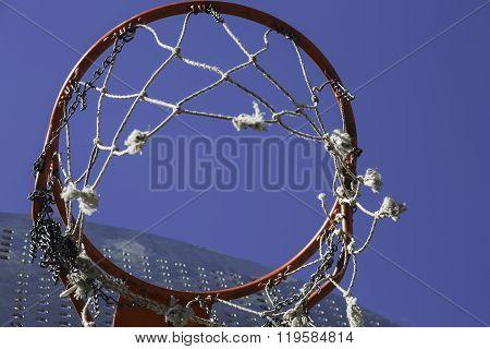 Orange Basketball Hoop On Blue Sky