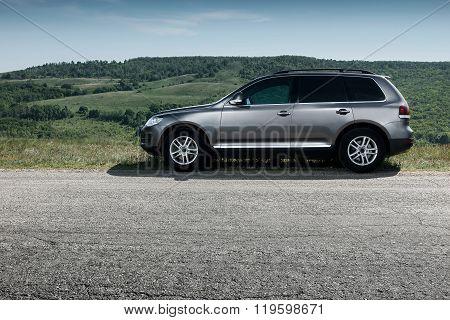 Saratov, Russia - May 18, 2014: Premium Car Volkswagen Touareg Stay On Asphalt Road Near Mountain At
