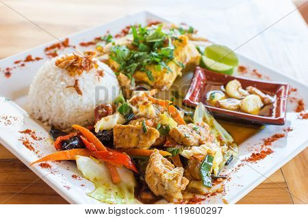 Traditional Balinese cuisine. Vegetable and chicken stir-fry with rice.