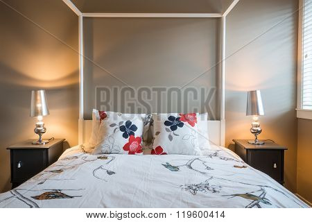 Beautiful bright rustic bedroom with bedside tables. Interior design.