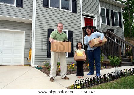 A family moves boxes into a new house