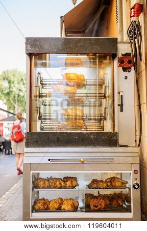 Grilled Roasted Chickens On City Street