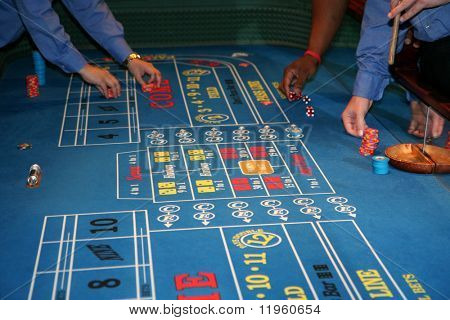Craps table with people gambing in Las Vegas