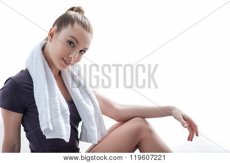 Beautiful female athlete is resting after training
