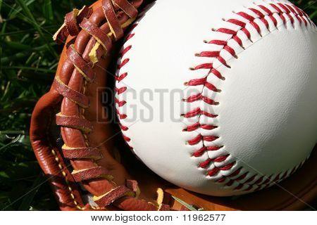 A baseball glove with a baseball poster