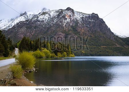 lake in mountains, big snow mountains with forest, bariloche, patagonia, argentina