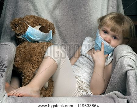 Small child with a toy bear cub in a medical mask. The girl is sad. Concept - an allergy to dust, wool, asthma. risk of infection, the viruses. poster