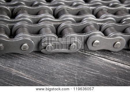 industrial drive roller chain on dark background