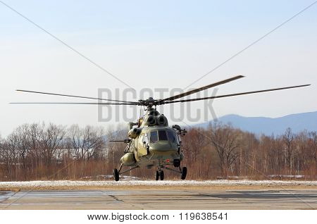 USSURIISK, RUSSIA - MARCH 24: Mi-8 military transport helicopter hovers on the competition skydivers