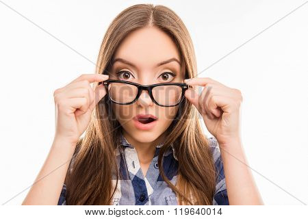 Surprised Pretty  Girl Taking Off Her Glasses, Close Up Photo
