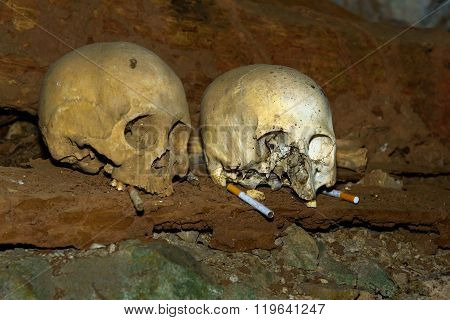 Skulls And Cigarettes In Tampangallo Burial Cave At Tana Toraja. Indonesia