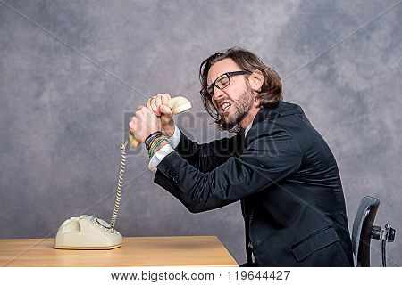 Angry Businessman Is Choking His Phone