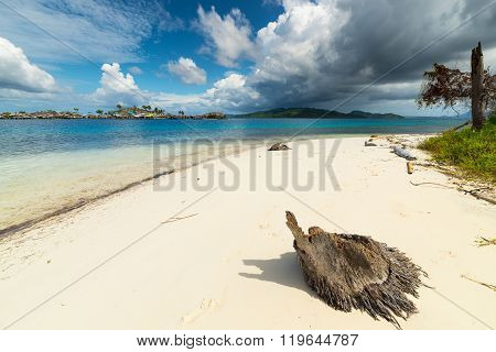 Tropical Storm Offshore On Indonesian Coastline And Scenic Beach