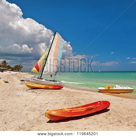Kayaks and catamarans at the beautiful beach of Varadero in Cuba