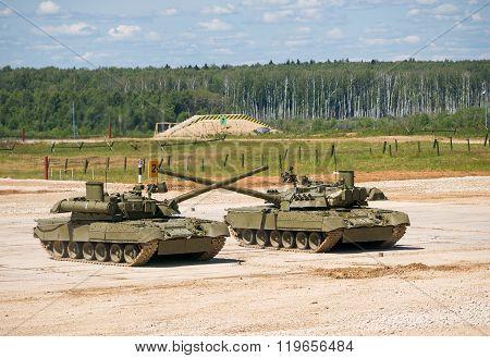 Two tanks T-80 crossed guns
