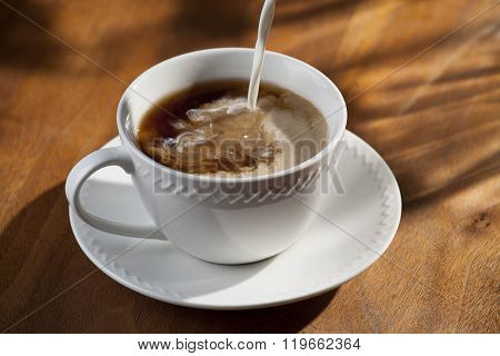 Cup or Coffee with Pouring Creamer