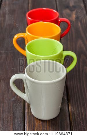 Four Color Empty Tea Cups Arranged In One Row