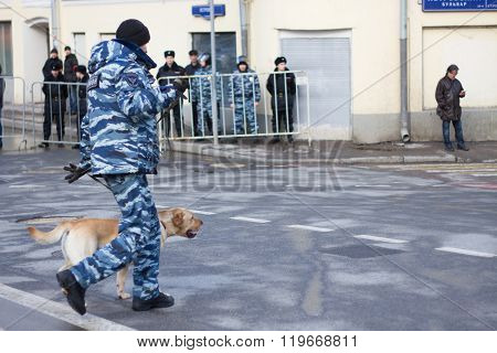 Policeman with a dog on the opposition action