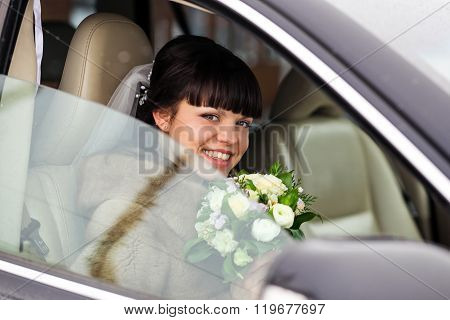 Bride in a car at her wedding day