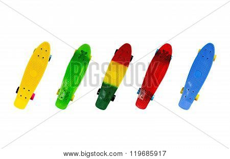 Colored mini skateboards isolated