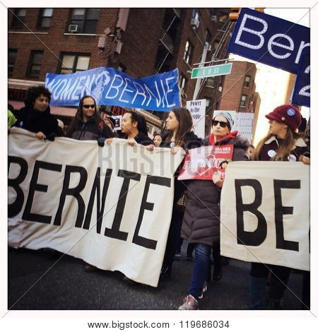 NEW YORK - 27FEB16: Supporters of US Presidential candidate Bernie Sanders carry signs and chant as they march down Broadway on February 27, 2016 in NYC