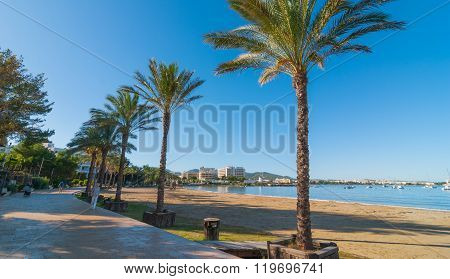 Mid morning sun on Ibiza waterfront.  Warm sunny day along the beach in St Antoni de Portmany Balear