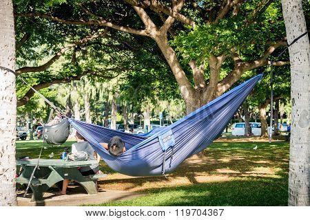 Person in hammock in Waikiki Beach Area
