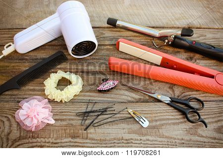 Hair accessories: hair dryer, curling iron, hair iron, comb, scissors, hair clips
